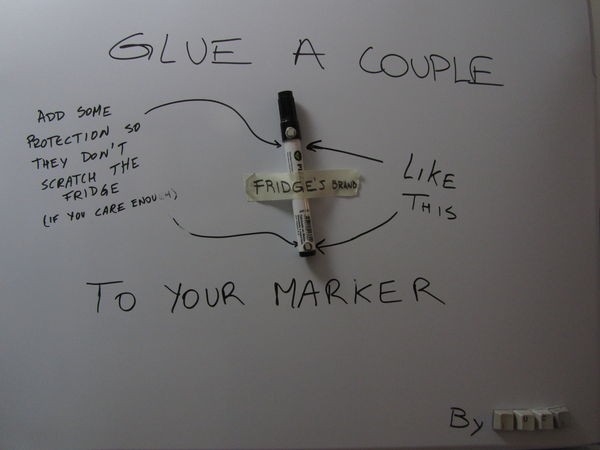 Glue a couple to your marker (add a protection so they don't scratch the fridge (if you care enough)